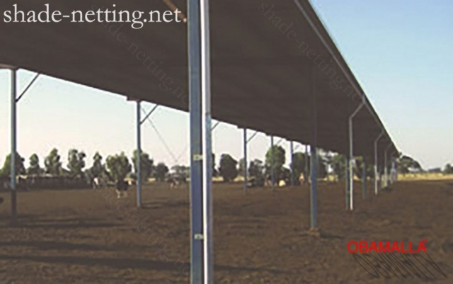 Shade cloth installed on the field for protection of cars and cattle.